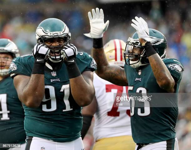 Fletcher Cox of the Philadelphia Eagles and Nigel Bradham react after Cox nearly picked off the ball in the second half against the San Francisco...