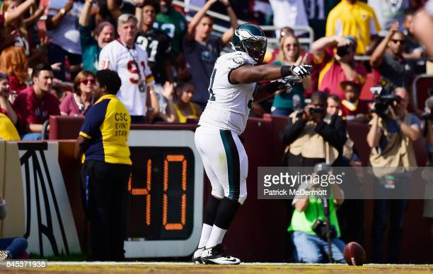 Fletcher Cox of the Philadelphia Eagles celebrates his touchdown against the Washington Redskins in the four quarter at FedExField on September 10...