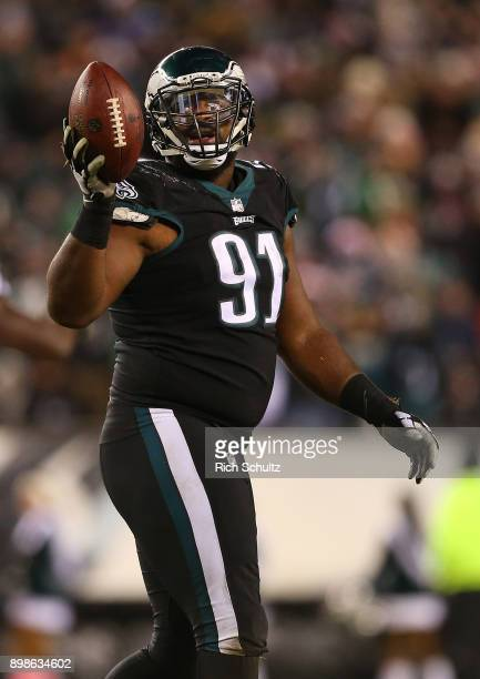 Fletcher Cox of the Philadelphia Eagles holds up the ball after recovering a fumble against the Oakland Raiders during the third quarter of a game at...