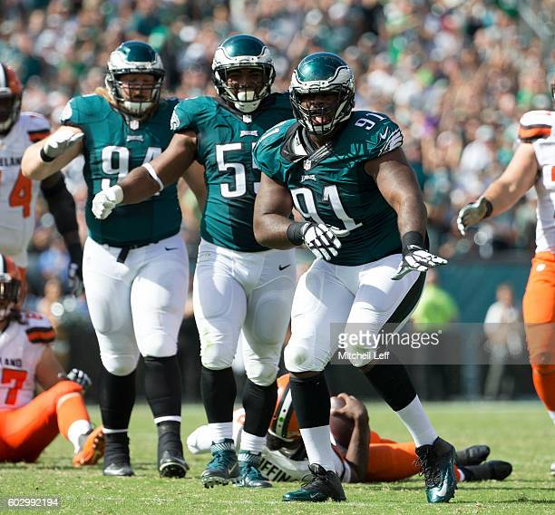 Fletcher Cox of the Philadelphia Eagles reacts after his sack of Robert Griffin III of the Cleveland Browns along with Brandon Graham and Beau Allen...