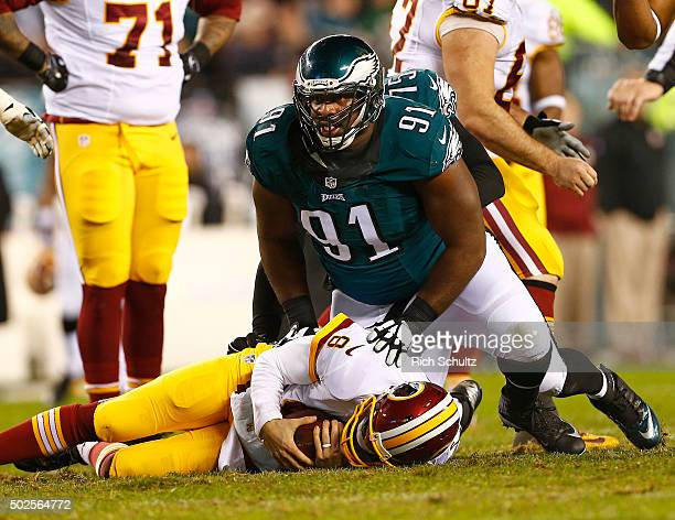 Fletcher Cox of the Philadelphia Eagles reacts after sacking quarterback Kirk Cousins of the Washington Redskins in the second quarter of a football...