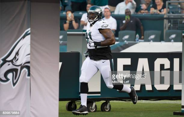Fletcher Cox of the Philadelphia Eagles runs onto the field prior to the preseason game against the Miami Dolphins at Lincoln Financial Field on...
