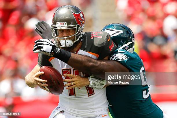 Fletcher Cox of the Philadelphia Eagles sacks Ryan Fitzpatrick of the Tampa Bay Buccaneers during the first half at Raymond James Stadium on...