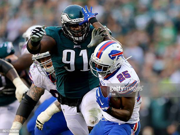 Fletcher Cox of the Philadelphia Eagles tackles LeSean McCoy of the Buffalo Bills at Lincoln Financial Field on December 13 2015 in Philadelphia...