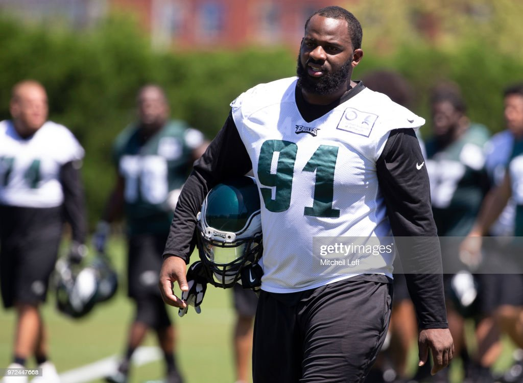 Fletcher Cox #91 of the Philadelphia Eagles walks off the field after Eagles minicamp at the NovaCare Complex on June 12, 2018 in Philadelphia, Pennsylvania.