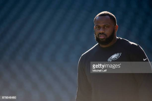 Fletcher Cox of the Philadelphia Eagles walks onto the field prior to the game against the Chicago Bears at Lincoln Financial Field on November 26...