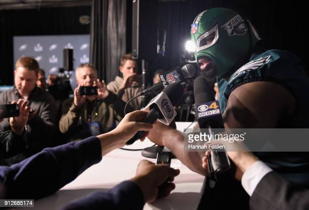 Fletcher Cox of the Philadelphia Eagles wears a mask as he speaks to the media during Super Bowl LII media availability on January 31 2018 at Mall of...