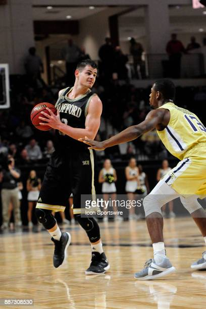 Fletcher Magee guard Wofford College Terriers checks defender Curtis Haywood II guard Georgia Tech Yellow Jackets Wednesday December 06 at Richardson...