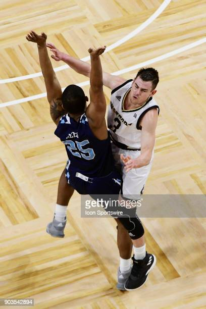 Fletcher Magee guard Wofford College Terriers passes the basketball over defender Alex Reed forward The Citadel Bulldogs Saturday January 6 at...