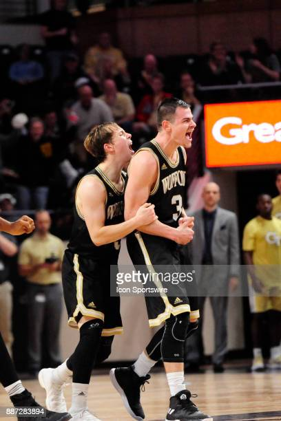 Fletcher Magee guard Wofford College Terriers scores the gamewinning threepointer and celebrates with teammate Storm Murphy guard Wednesday December...