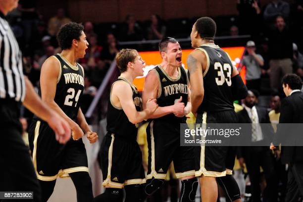 Fletcher Magee guard Wofford College Terriers scores the gamewinning threepointer and celebrates with teammates Keve Aluma forward Storm Murphy guard...