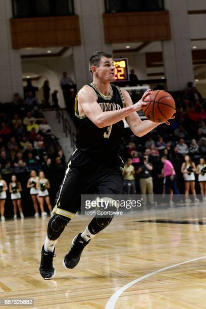 Fletcher Magee guard Wofford College Terriers sets to shoot another threepointer Wednesday December 06 at Richardson Indoor Stadium in Spartanburg...