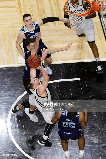 Fletcher Magee guard Wofford College Terriers shots for two against Alex Reed forward Hayden Brown forward and Zane Najdawi forward The Citadel...