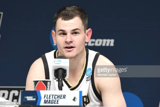 Fletcher Magee of the Wofford Terriers addresses the media after the First Round of the NCAA Basketball Tournament against the Seton Hall Pirates at...