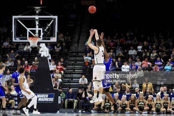 Fletcher Magee of the Wofford Terriers attempts a shot while being guarded by Quincy McKnight of the Seton Hall Pirates in the second half during the...