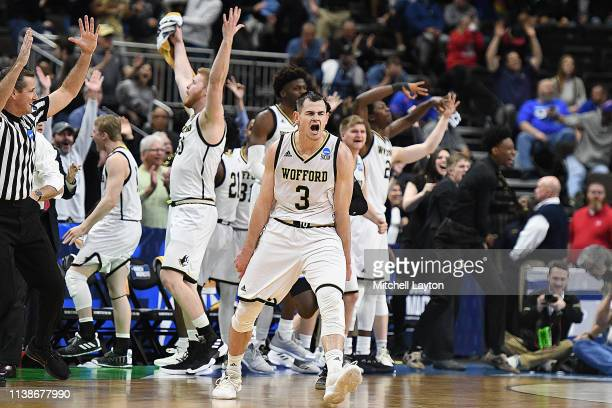 Fletcher Magee of the Wofford Terriers celebrates a shot during the First Round of the NCAA Basketball Tournament against the Seton Hall Pirates at...