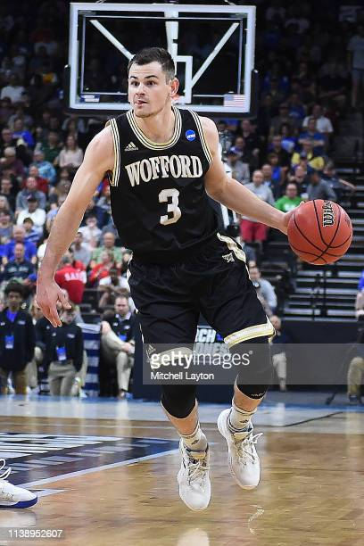 Fletcher Magee of the Wofford Terriers dribbles the ball during the Second Round of the NCAA Basketball Tournament against the Kentucky Wildcats at...