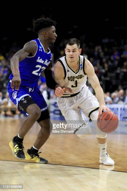 Fletcher Magee of the Wofford Terriers dribbles the ball while being guarded by Myles Cale of the Seton Hall Pirates in the first half during the...