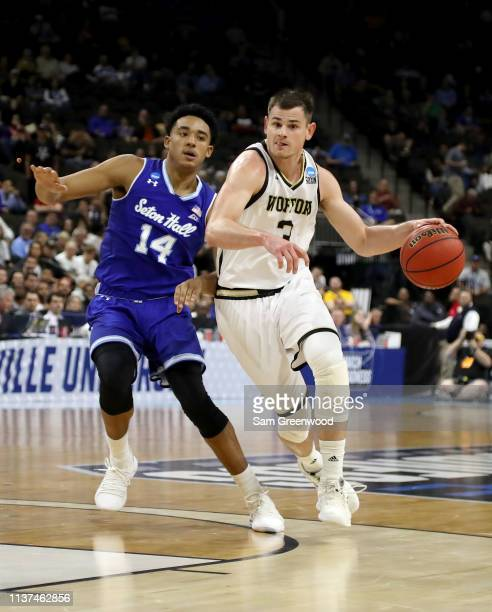 Fletcher Magee of the Wofford Terriers dribbles the ball while being guarded by Jared Rhoden of the Seton Hall Pirates in the second half during the...