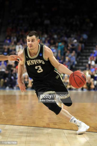 Fletcher Magee of the Wofford Terriers drives against the Kentucky Wildcats during the first half of the game in the second round of the 2019 NCAA...