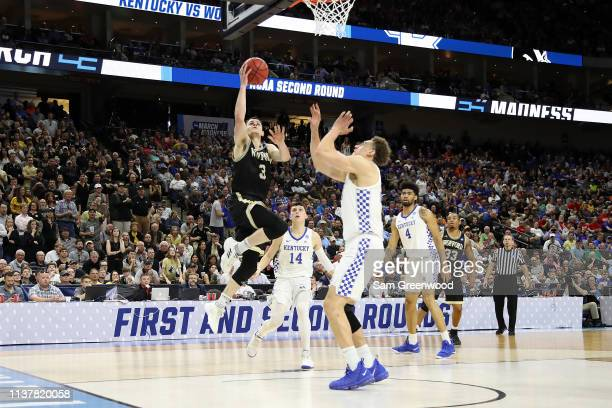 Fletcher Magee of the Wofford Terriers shoots against the Kentucky Wildcats during the second half of the game in the second round of the 2019 NCAA...