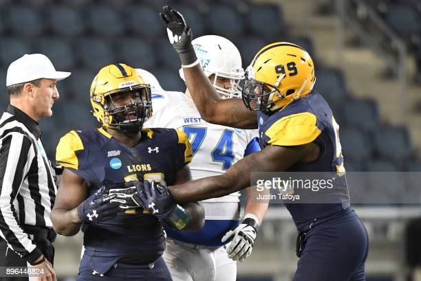 D Fletcher of Texas AM Commerce celebrates a sack during the Division II Men's Football Championship held at Sporting Park on December 16 2017 in...
