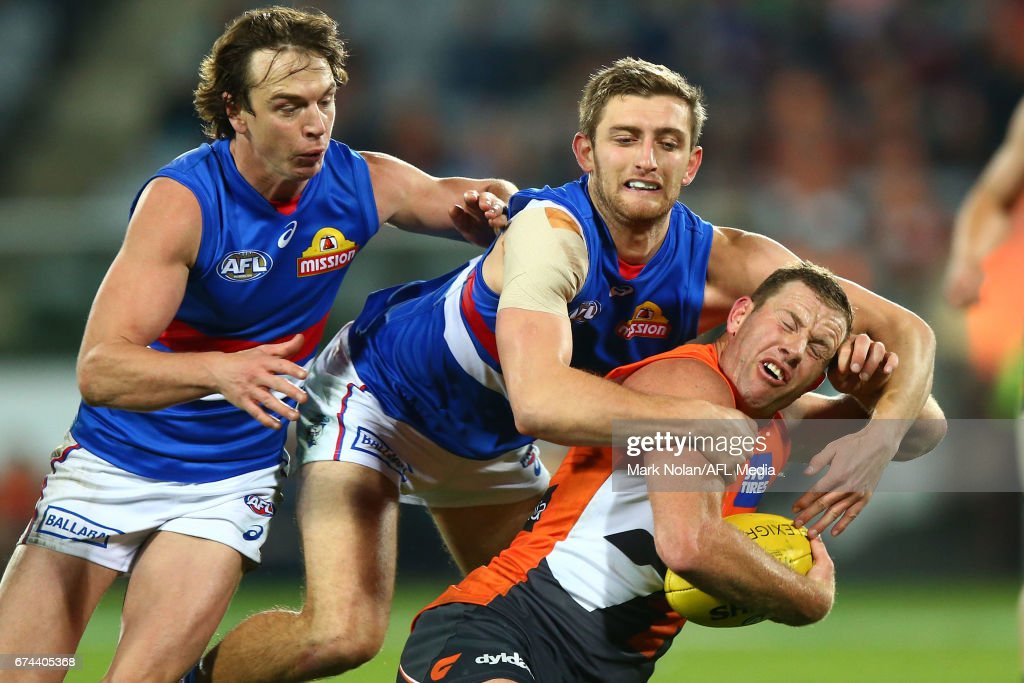 Fletcher Roberts of the Bulldogs tackles Steve Johnson of the Giants during the round six AFL match between the Greater Western Sydney Giants and the Western Bulldogs at UNSW Canberra Oval on April 28, 2017 in Canberra, Australia.