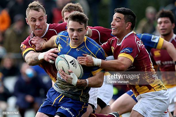 Fletcher Smith of Otago in the tackle of Jimmy Cowan and Wharenui Hawera of Southland during the round one Mitre 10 Cup match between Southland and...