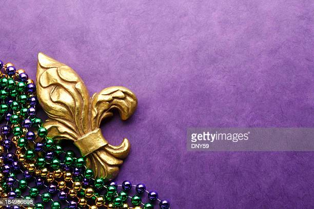 fleur de lys & mardi gras beads - new orleans mardi gras stock photos and pictures