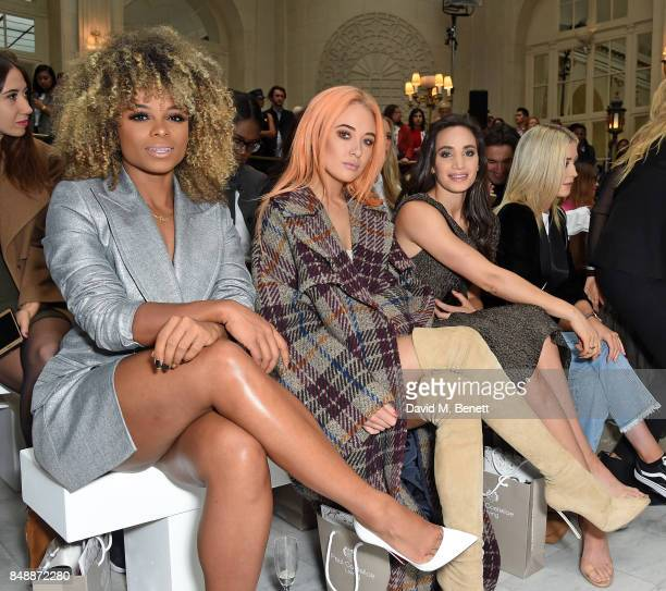 Fleur East Nicola Hughes and Laura Wright attend the Paul Costelloe catwalk show during London Fashion Week at The Waldorf London on September 18...
