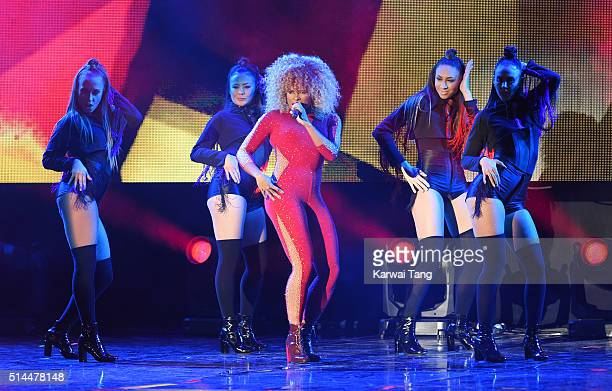 Fleur East performs on stage during WE Day at SSE Arena on March 9 2016 in London England WE Day is a celebration of youth making a difference in...