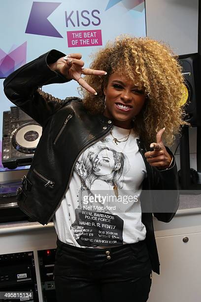 fleur east poses for a photo at Kiss FM Studio's on November 5 2015 in London England