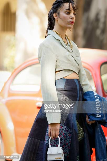 Fleur Egan wearing Jacquemus cropped beige jacket, Junya Watanabe patchwork skirt, Balenciaga denim jacket, MM6 by Maison Margiela necklace and beige...