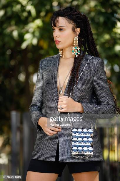 Fleur Egan wearing Yves Saint Laurent blazer Paco Rabanne sequin mini bag Maison Poi black shorts and silver strap heels on September 24 2020 in...