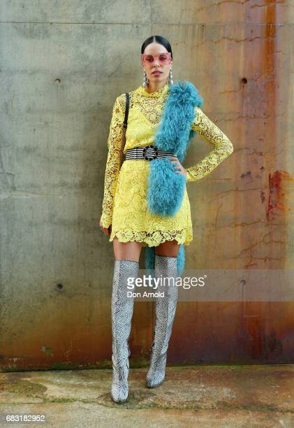 Fleur Egan wears Kate Sylvester outfit Pared sunglasses Gucci bag Chanel belt and vintage accessories during MercedesBenz Fashion Week Resort 18...