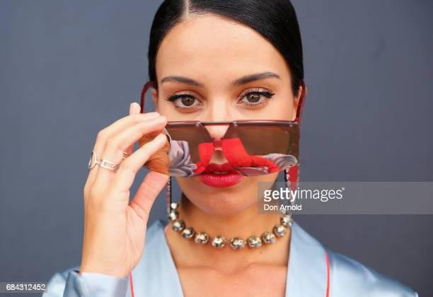 Fleur Egan wears Willow and May jump suit Karen Walker sunglasses and From St Xavier clutch wearing during MercedesBenz Fashion Week Resort 18...