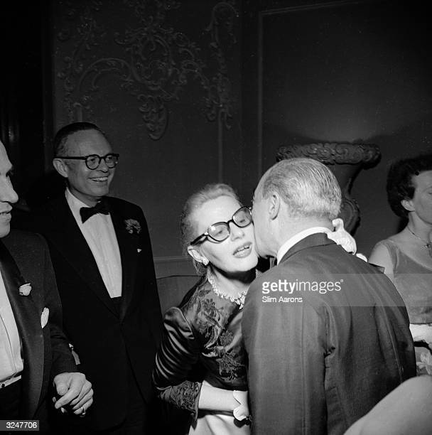 Fleur Fenton Cowles writer and Associate Editor of Look magazine greets composer and songwriter Richard Rodgers at a party given by Mary Martin at...