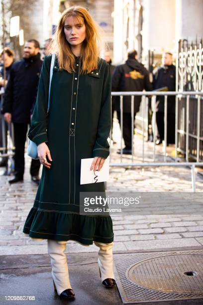 Fleur Geffrier, wearing a green midi dress, cream boots and light blue bag, is seen outside Lanvin, during Paris Fashion Week - Womenswear...