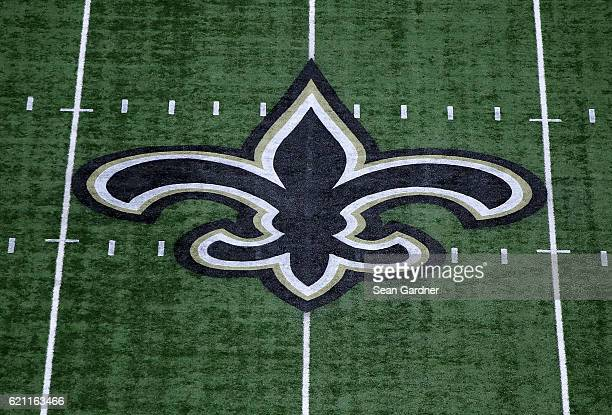 A fleurdelis marks the fifty yard line on the field for the New Orleans Saints at the MercedesBenz Superdome on October 30 2016 in New Orleans...