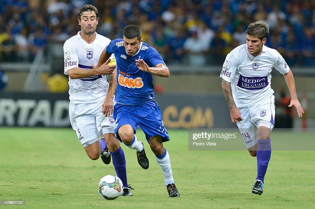 Fleurquin Andres (L) and Gino Federico (R) of Defensor and Egidio of Cruzeiro during the match between Cruzeiro v Defensor for the Copa Briedgestone Libertadores 2014 at Mineirao stadium on march 20, 2014 in Belo Horizonte, Brazil.