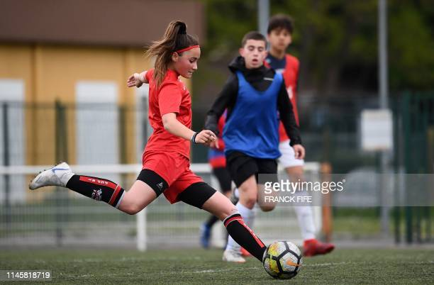 Fleury 91's Under 14 football player Maelle takes part in a mixed-gender football training session on May 6 at the Auguste-Gentelet stadium in...