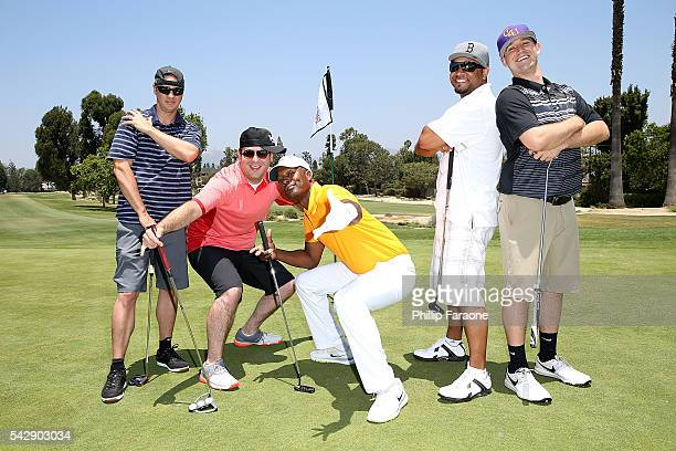Flex Alexander poses for a photo with participants during BETX Golf at Wilshire Country Club on June 24 2016 in Los Angeles California