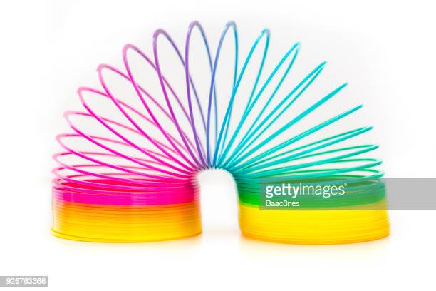 flexibility - colorful slinky toy - flexibility stock pictures, royalty-free photos & images