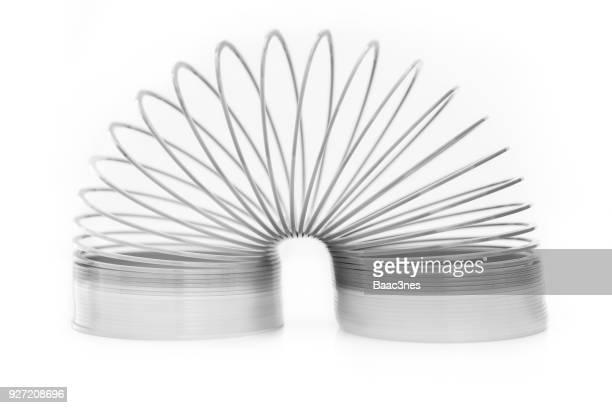 flexibility - slinky toy - espiral de metal - fotografias e filmes do acervo