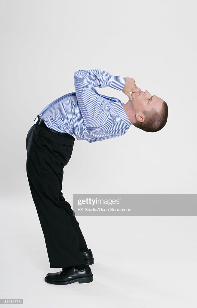 Flexible Businessman Contorted In Thinking Pose Stock Photo