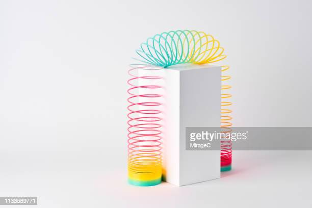 flexible coil striding cuboid shape - striding stock pictures, royalty-free photos & images