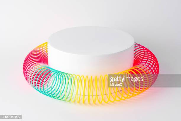 flexible coil surrounding cylinder - surrounding stock pictures, royalty-free photos & images