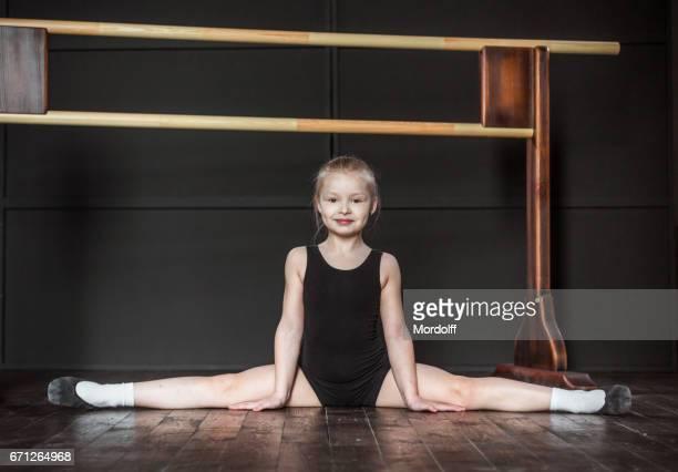Flexible Little Dancer Sitting In Split