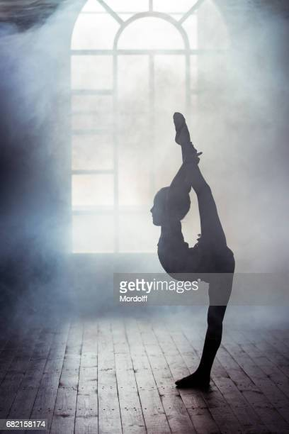 flexible little gymnast - rhythmic gymnastics stock pictures, royalty-free photos & images