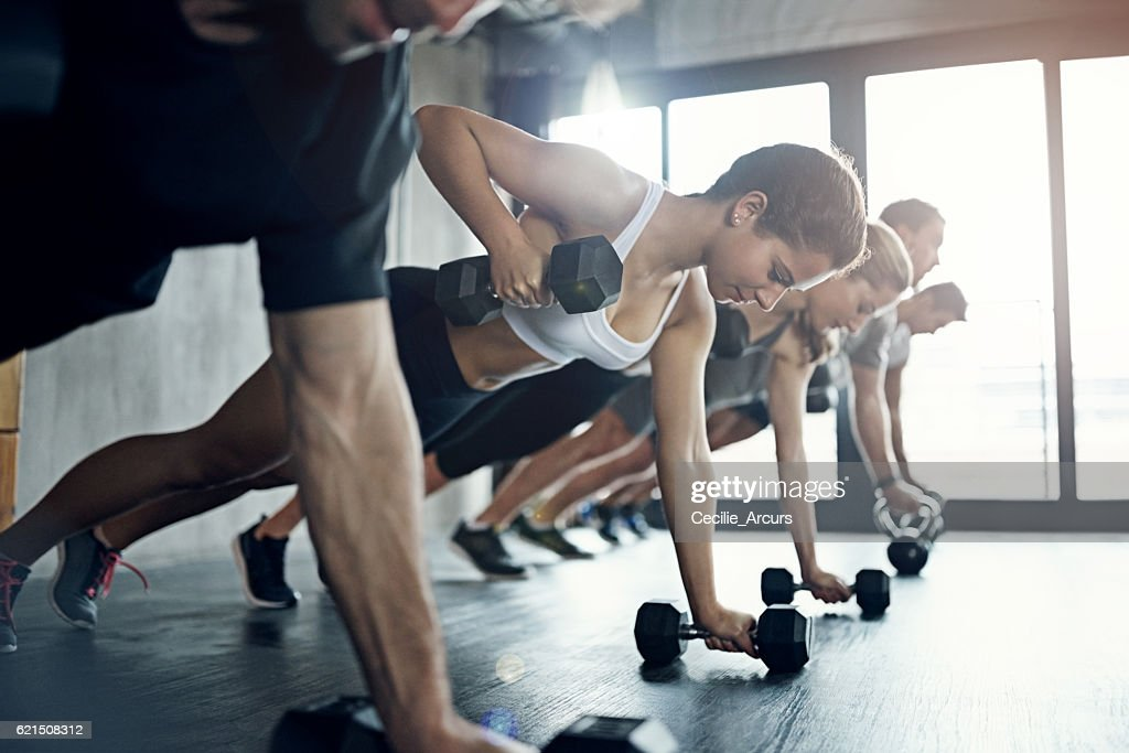 Flexing more than just her physical muscles : Stock Photo